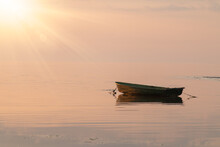 Relaxing Seascape With A Fishing Boat In The Background. Beautiful Morning Above The Sea