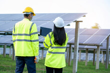 Engineers With Architects Examining Solar Power Plant