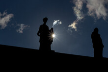 Silhouette Of Statues Of Muses With Sun Rays