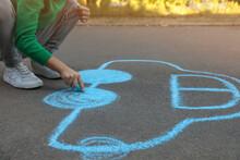 Child Drawing Car With Chalk On Asphalt, Closeup