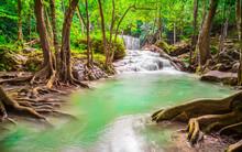 Waterfall In The Emerald Blue Water In Erawan National Park. Erawan Waterfall Is A Beautiful Natural Rock Waterfall In Kanchanaburi, Thailand.Onsen Atmosphere