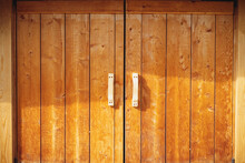 A Wooden Barn Or Chicken Coop Gate, Possibly A Barn With Wooden Handles.