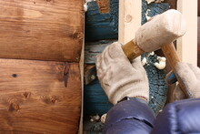 Preparation Of Old Walls Of A House Made Of Painted Logs For The Installation Of Protective And Decorative Wood Sheathing