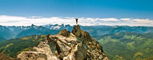 Hiker Celebrates Hiking To The Summit Of A Rocky Mountain, Scenic View