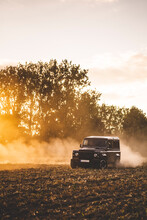 A Jeep Drives Offroad In A Field