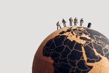 Group Of Soldiers On Top Of The Earth Globe. Military Concept