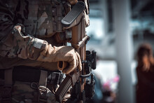 Close-up Of A Soldier Holding Modern Rifle