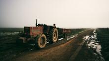 A Lone Tractor On A Muddy Farm Road At Dawn Somewhere In Knysna.