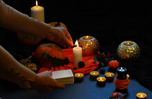 High Angle View Of Hand Holding Candles On Table