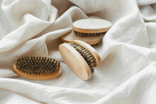 Bamboo Beard Brushes With Natural Bristles On Linen Textile Background. Facial Care Concept For Men. Natural Zero-waste