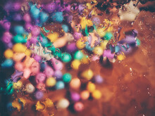 Blurred Images Of Beads With Many Colors. Concepts For The Background For The Design.
