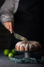 Lemon Bundt Cake On Black Background Accompanied By Lemons