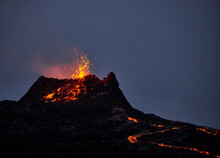 Hot Magma Erupting From Volcanic Mountain At Night