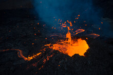 Burning Lava Flowing From Active Volcano Crater