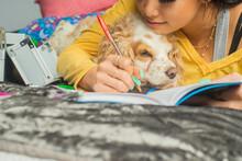 Gen Z Writing In Her Journal With Her Pet Cocker Spaniel