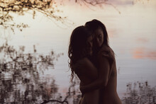 Soft Embrace Of Lesbian Queer Couple Hugging By Romantic Lake