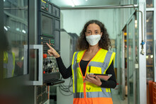 Engineer Woman Wearing Protection Face Mask Working