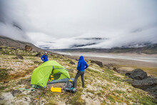 Campers Prepare Campsite For The Approaching Storm.