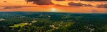 A Stunning Aerial Panoramic Shot Of Vast Miles Of Lush Green Trees With Powerful Clouds In The Sky With Homes Nestled Into The Trees At Huddleston Pond Park In Peachtree City, Georgia