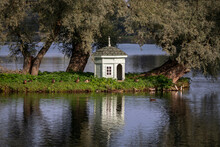 A House For Swans On An Island In The White Lake On The Territory Of The Gatchina Palace And Park Complex On A Sunny Autumn Day, Gatchina, St. Petersburg, Russia