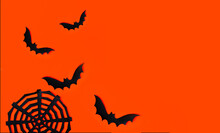 Orange Background With Black Bats And Cobwebs - Background For Halloween. Place For Text, Banner.