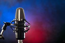 Studio Microphone On A Colorful Background. Minimalism. Recording Studio, Vocals, Instruments, Clear Sound, Conversational Genre, Concert, Nightclub.