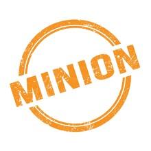 MINION Text Written On Orange Grungy Round Stamp.