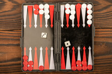 Backgammon Board With Chips And Dice On A Wooden Table, Close-up, Selective Focus.