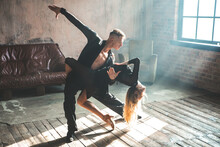 Couple Of Two Professional Ballroom Dancers Is Dancing On Loft Studio. Beautiful Art Performance With Heavy Smoke. Sport Life Concept. Passion And Emotional Dance.
