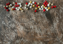 Colourful Jingle Bells On  Grey Stone Surface