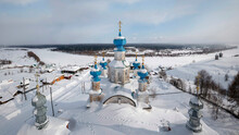 View Of The Wonderful Provincial Town Of Cherdyn (Russia) And The Frozen River In Winter. Close-up Of The Blue Domes Of The Old Resurrection Cathedral 1750. Cherdyn, Perm Territory, Russia