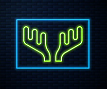 Glowing Neon Line Deer Antlers Icon Isolated On Brick Wall Background. Hunting Trophy On Wall. Vector