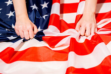 Crop Person Touching Crumpled Flag Of USA