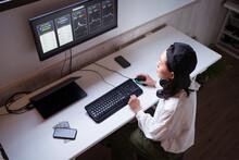 Serious Ethnic Female Trader Analyzing Cryptocurrency Market Statistics