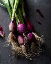 Raw Purple Onions Places On Table
