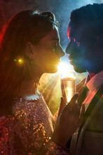 Crop Romantic Multiracial Couple With Champagne During New Years Eve