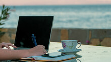 Woman Remote Working Outside Writing And Taking Notes At The Beach, Mobile Writer In Holiday