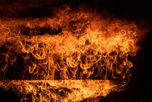 Burning Red Hot Sparks Rise From Large Fire,Close Up Fire Flames From Gas Explosion On Black Background.