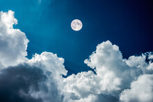 Magical View Of A Nighttime Sky With Clouds With Large Full Moon.