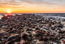 Sundown On The Rock Pier. Dusk Over The Rocky Sea. Golden Sunset At Windy Evening At Rock Pier What Separates Calm Sea And Windy Waves At Tahkuna, Hiiumaa, Estonia.