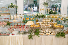 Candy Bar. Delicious Wedding Buffet With Cupcakes. Sweet Buffet With Cupcakes And Other Desserts.