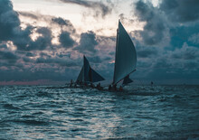 Scenic Photo Of Sailboats In The Ocean. Picturesque Picture Of Two Sailing Ships In The Sea. Blue Colours