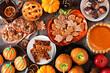 Leinwandbild Motiv Fall desserts table scene with a mixture of sweet autumn treats. Top down view over a dark wood background.