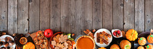 Autumn Desserts Bottom Border. Table Scene With Assorted Sweet Fall Treats. Top View Over A Rustic Wood Banner Background. Copy Space.