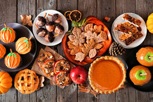Autumn Desserts Table Scene With A Variety Of Sweet Fall Treats. Above View Over A Dark Wood Background.