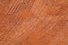 Abstract Natural Background From Texture Of Orange Red Terracota Clay Soil