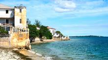 Coastal Area With Old Stone Buildings. Ocean Shore.
