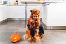 Little Cute Boy Dressed As Werewolf Gesturing While Scaring The Camera During Halloween Celebration