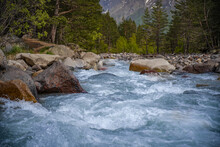 Rapids And Cascades Of Violent Mountain River. Close Up View