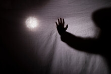 Halloween. A Shadow Or Silhouette Of Two Hands, With A White Cloth. In Transparency With Space To Copy Your Text